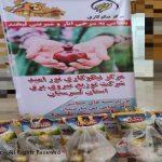 توزیع بسته های موادغذایی به خانواده های نیازمند در مرکز نیکوکاری نورامید